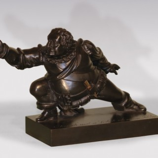 An unusual early 19th Century cast iron Inkwell, in the form of Sir John Fallstaff.