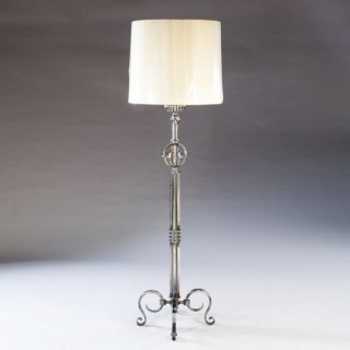 A 1940S STEEL LAMPSTAND ATTRIBUTED TO GILBERT POILLERAT