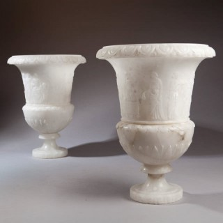A PAIR OF CARVED CLASSICAL ALABASTER VASES