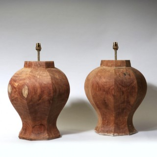 A PAIR OF FACETED OCTAGONAL WOODEN LAMPS