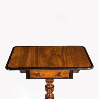 A Ceylonese satinwood and ebony Pembroke table