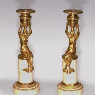 A Pair of Regency period ormolu mermaid Candlesticks.