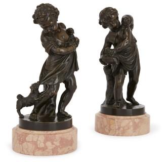 Pair of antique bronze figures of cherubs and animals