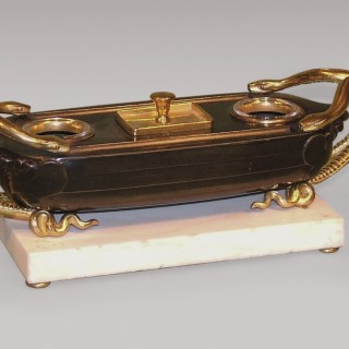 An antique French bronze and ormolu boat-shaped Pentray.