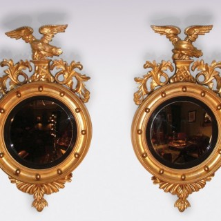 A Pair of 19th Century giltwood Convex Mirrors.