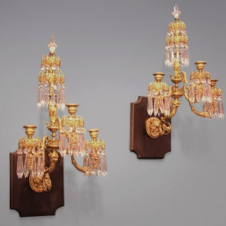 A pair of English Regency period gilt bronze Wall Lights.