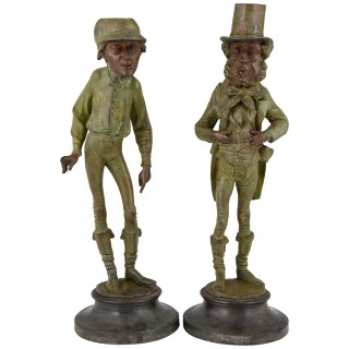 A pair of figural candlesticks jockey and gentleman