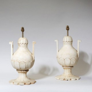 A PAIR OF PETAL CARVED MUGHAL WOODEN LAMPS