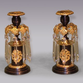 A pair of 19th Century bronze and ormolu Lustre Candlesticks.