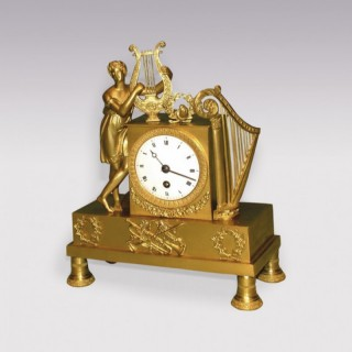 An attractive small early 19th Century French Mantel Clock.