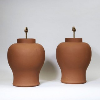 A PAIR OF TERRACOTTA BALUSTER LAMPS