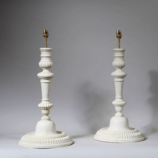 A PAIR OF TURNED WOODEN CANDLESTICK LAMPS