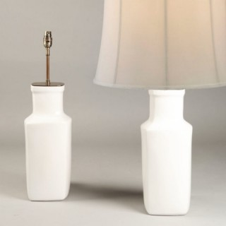 A PAIR OF WHITE CHINESE VASES AS LAMPS