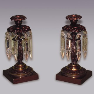 Pair of Regency period bronze and ormolu Lustre Candlesticks.