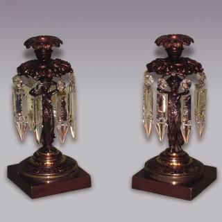 Pair of Regency period bronze and ormolu Lustre Candlesticks.