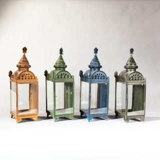 A SET OF FOUR TOLE WALL LANTERNS