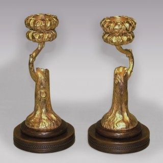 An unusual pair of mid 19th Century bronze and ormolu Candlesticks.