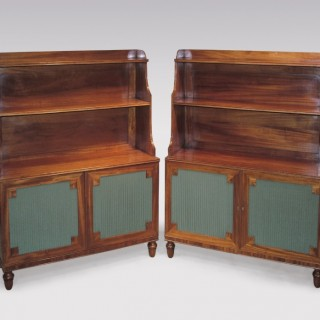 A pair of Regency period figured mahogany Waterfall Bookshelves.