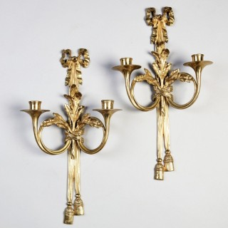 PAIR OF NEO-CLASSICAL TWO BRANCH WALL APPLIQUES AFTER JEAN-JACQUES CAFFIERI