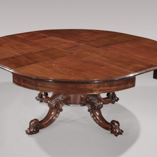 An impressive mid 19th century figured mahogany circular Dining Table with unusual wind-out mechanism.