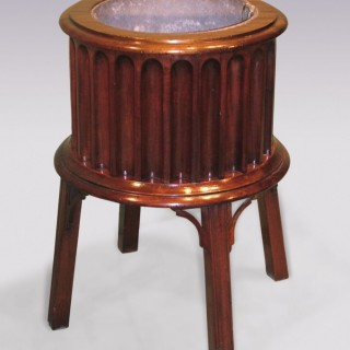 A George III period mahogany drum-shaped Jardiniere.