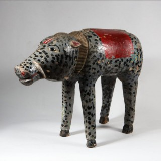 AN AMUSING CARVED WOODEN FIGURE OF A WILD BOAR