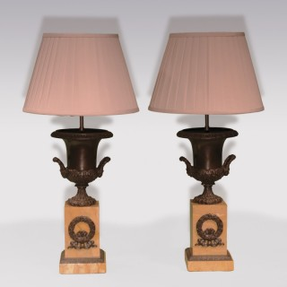A pair of early 19th Century bronze Urn Lamps.