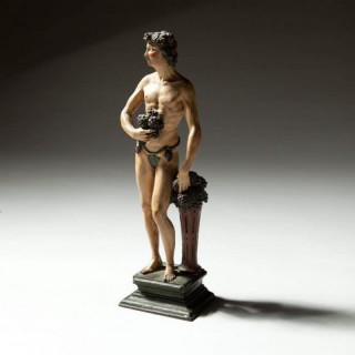 17TH CENTURY FLEMISH CARVED WOODEN POLYCHROME FIGURE OF BACCHUS