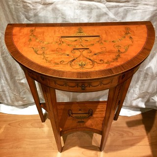 An Edwardian inlaid satinwood demi lune console table