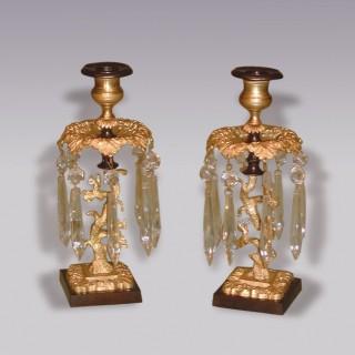 Pair of Regency bronze and ormolu Candlesticks.