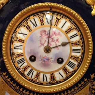 A Gilt-Bronze Mounted Sèvres-Style Blue Ground Mantel Clock, painted with Venus and Cupid