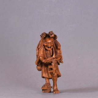 A WELL CARVED JAPANESE CARVED WOODEN NETSUKE - ABURA BOZU - THE OIL THIEF