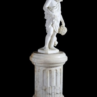 IMPORTANT 19TH CENTURY CARVED MARBLE SCULPTURE OF YOUNG BACCHUS ON CARVED FLUTED MARBLE PEDESTAL BY PROFESSORE GIUSEPPE LAZZERINI