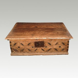 Early carved oak boarded box.