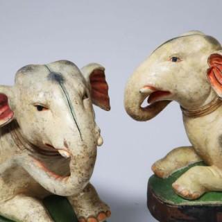 PAIR OF POTTERY PAINTED RECUMBENT ELEPHANTS