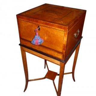 An Edwardian satinwood jewellery box on stand.