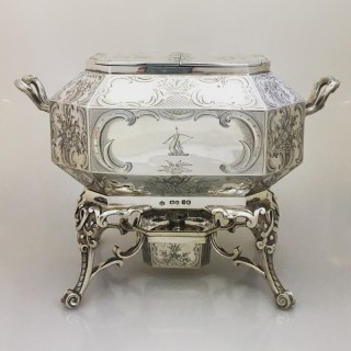 A Victorian silver muffin warmer by George Fox, London 1874.