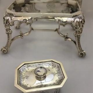 A Victorian silver muffin warmer by George Fox, London 1874.