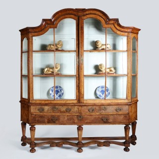 A walnut dutch display cabinet