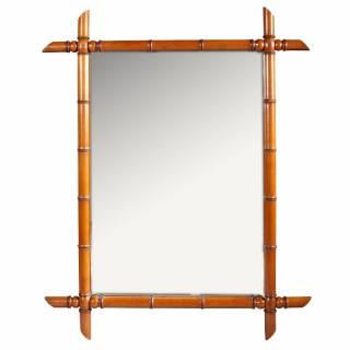 A Charles X simulated bamboo mahogany mirror