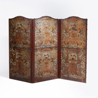 A three fold screen of Flemish leather