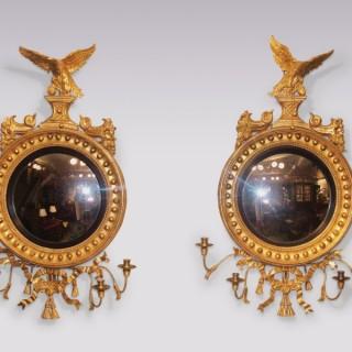 Pair of Regency period carved giltwood Convex Mirrors.