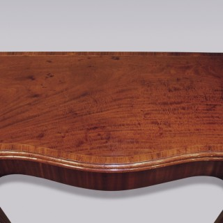 A late 18th Century Hepplewhite mahogany serpentine Card Table.