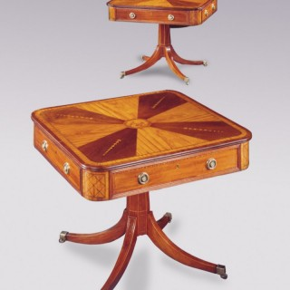 A pair of Irish 19th Century mahogany and satinwood Centre Tables.