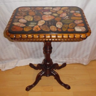 A Victorian walnut and specimen marble gueridon table