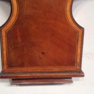 Mahogany wheel barometer by Chadburn's Ltd of Liverpool.