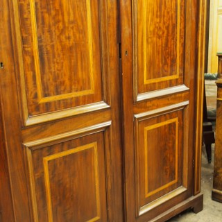 William IV Mahogany and Inlaid Three Door Wardrobe