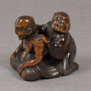 HUMOROUS JAPANESE 18THC WOOD AND LACQUER NETSUKE OF THE BLIND MASSEUR