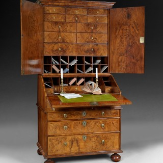 Early James II/ William and Mary Period highly figured walnut bureau cabinet