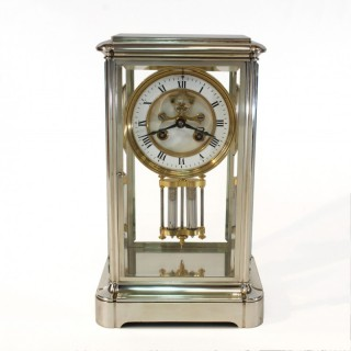 French antique silver four glass clock